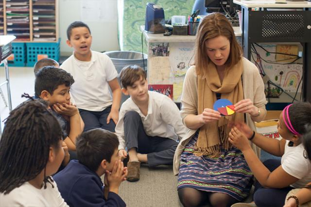 Adelaide Oneal Xie in classroom with students