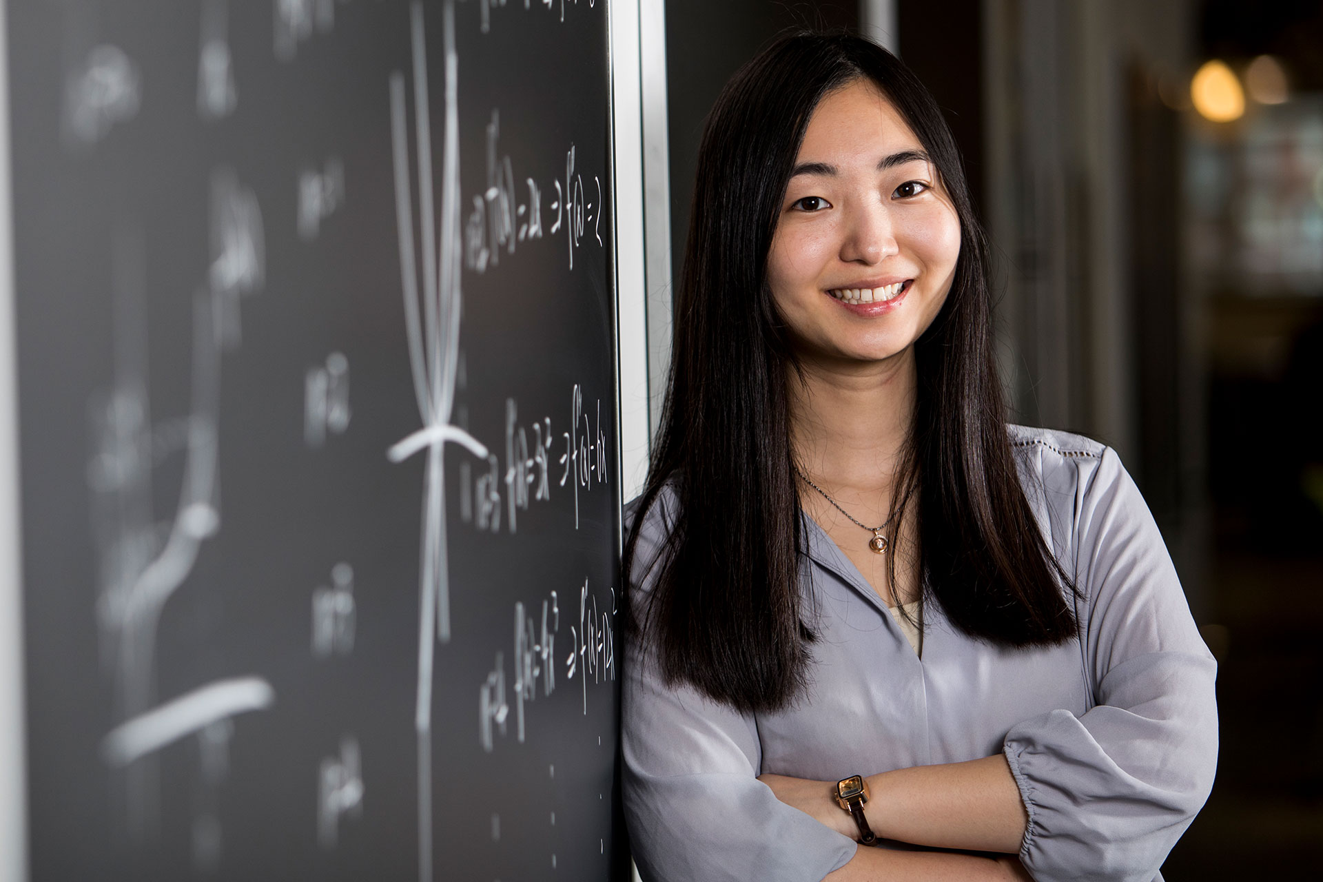 Ph.D. candidate Joanne Lin in the CLIC building at Tufts University