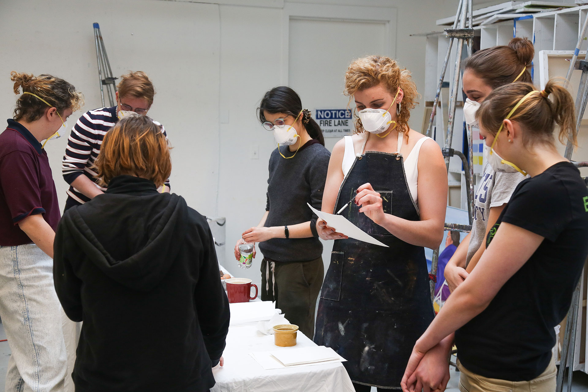 Brooke Stewart, MFA '18, shows students how to make paint with eggs during the Egg Tempera workshop.