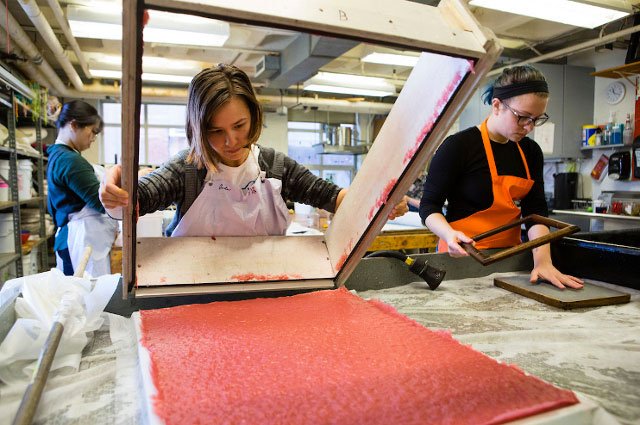 Students at the SMFA participate in a papermaking class
